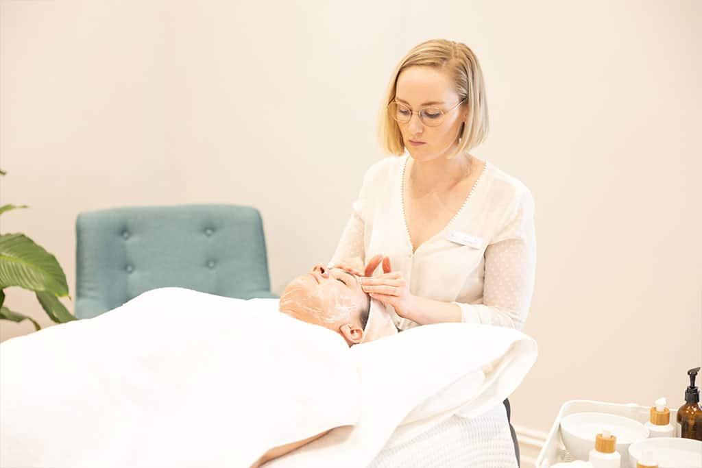 Adelaide Naturopath Karina giving an organic facial treatment